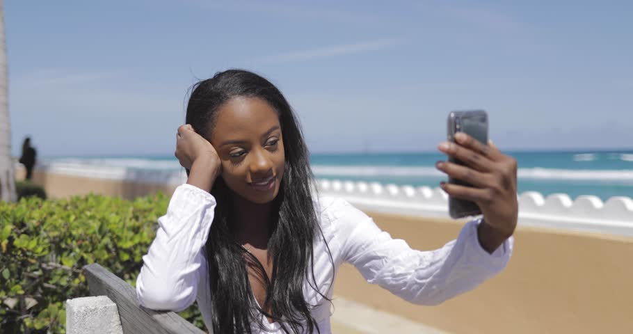 Smiling young attractive woman taking selfie | Shutterstock HD Video #1009203917