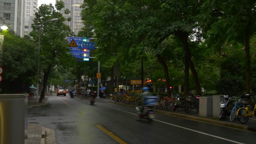 SHANGHAI, CHINA - SEPTEMBER 15 2017: rainy day shanghai city traffic street panorama 4k circa september 15 2017 shanghai, china.