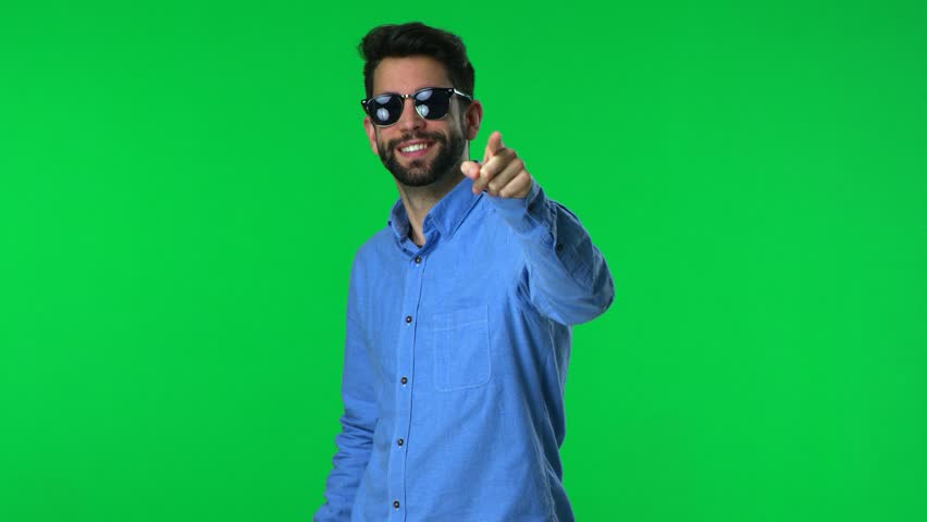 Man pointing over a green screen background | Shutterstock HD Video #1009303877