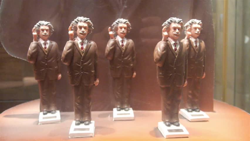 Albert Einstein Moving Figurine On Shelf Behind Showcase - Static