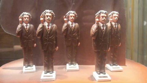 Albert Einstein Moving Figurine On Shelf Behind Showcase - Static