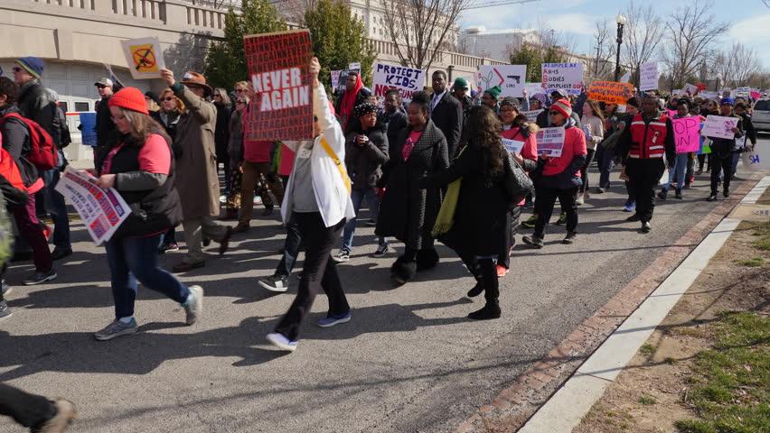 Washington, DC March 24, 2018. Tracking shot of Protestors marching, March of Our lives Protest, Washington DC, 3 Axis Gimbal