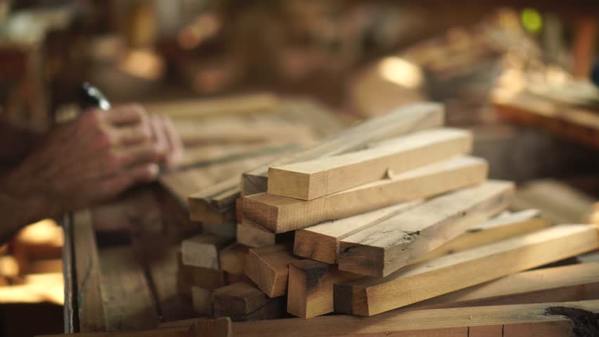 Carpenter working on a Wooden in his Workshop, preparing a detail of wooden product, Cabinet maker planes | Shutterstock HD Video #1009358207