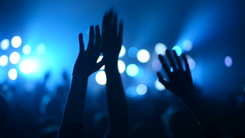 Hands on foreground in concert | Shutterstock HD Video #1009374497