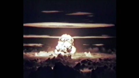 CIRCA 1956 - Nuclear explosions are shown and a Martin B-57 Canberra aircraft penetrates the base of a mushroom cloud during Operation Redwing.