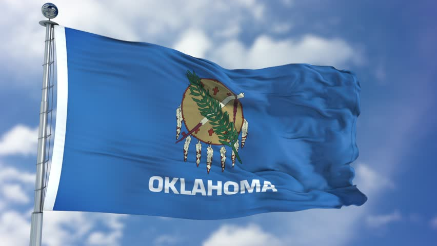 Oklahoma (U.S. state) flag waving against clear blue sky, close up, isolated with clipping path mask luma channel, perfect for film, news, composition
