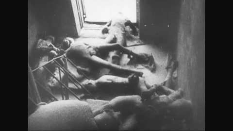 CIRCA 1940s - Young Russian girls abused by German soldiers are saved and Russian civilians look at Russians killed by Germans by hanging during WWII.