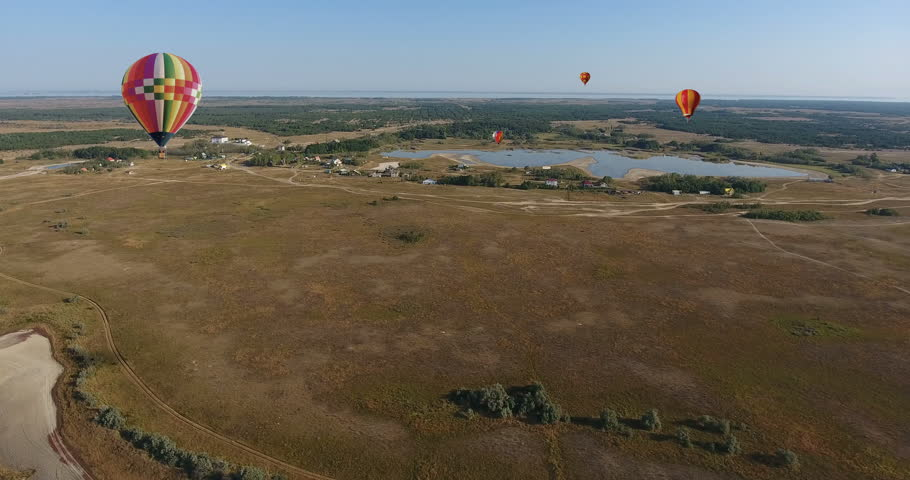 Aerial view, Hot air balloon in sky over field and forest in summer landscape countryside