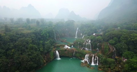 AERIAL 4K: above the Ban Gioc Waterfall at cloudy March  - the most magnificent waterfall in Vietnam