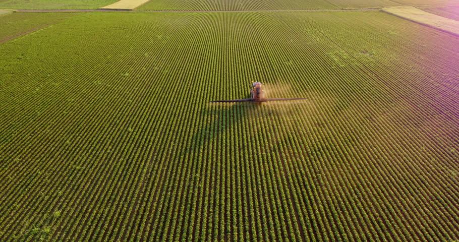 Aerial drone shot of a farmer spraying soybean fields | Shutterstock HD Video #1009501757