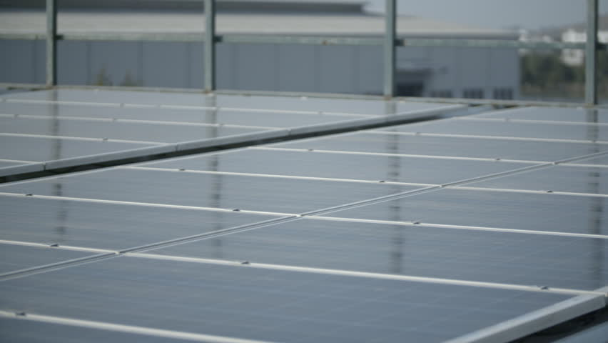 Roof top solar panels on environmentally friendly factory, shot in evening sunset. | Shutterstock HD Video #1009532747