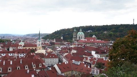 the red tiled roofs of prague buildings as seen from prague castle in the czech republic