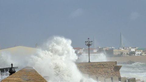 Giant Storm Wave Surging Over Seawall