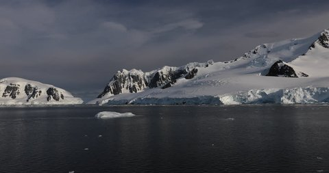 Icebergs float in the water after breaking off glaciers near Paradise Harbor in Antarctica, where a colony of Gentoo Penguins live. Scientists are currently studying the effects of climate change.