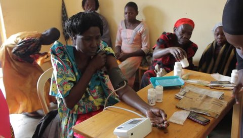 Uganda. 25 April 2017. A Ugandan woman's blood pressure is being mesured by health care worker in a makeshift clinic in Uganda.
