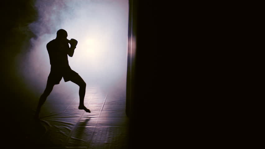Man Punches In Boxing Gym. Shadow Boxing.