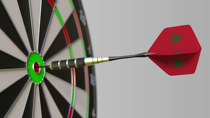 Dart featuring flag of Morocco hits bullseye of the target. Sports or political success related conceptual animation