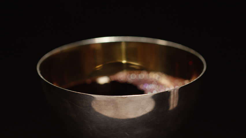 Focus across chalice of wine