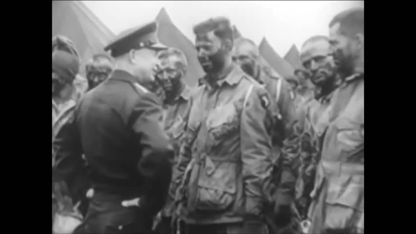 CIRCA 1944-Dwight D Eisenhower meets with a group of paratroopers before a mission during WWII.