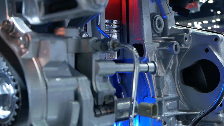 Inside view of engine, close up detail of two pistons in cylinder,some gears aside. | Shutterstock HD Video #1009640597