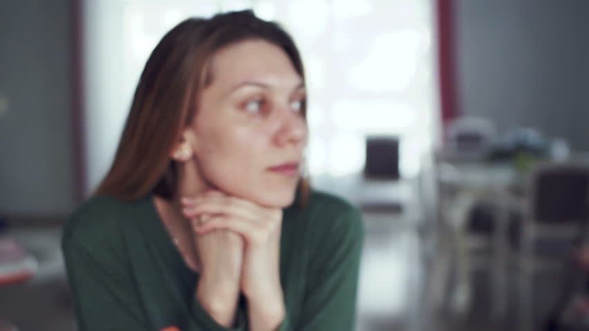 close-up of a girl looking away thoughtfully. sadness on the face of a woman