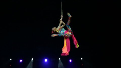Performance of the girl aerial acrobat in the circus.