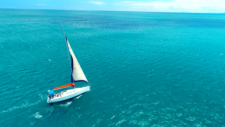 Yacht sailing on open sea at sunny day. Sailing boat in slow motion. Sailing aerial 4k video