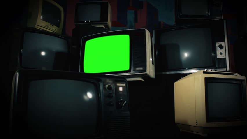 Old Tv Green Screen with Many 1980s Tvs. Zoom In. Ready to replace green screen with any footage or picture you want. | Shutterstock HD Video #1009774007