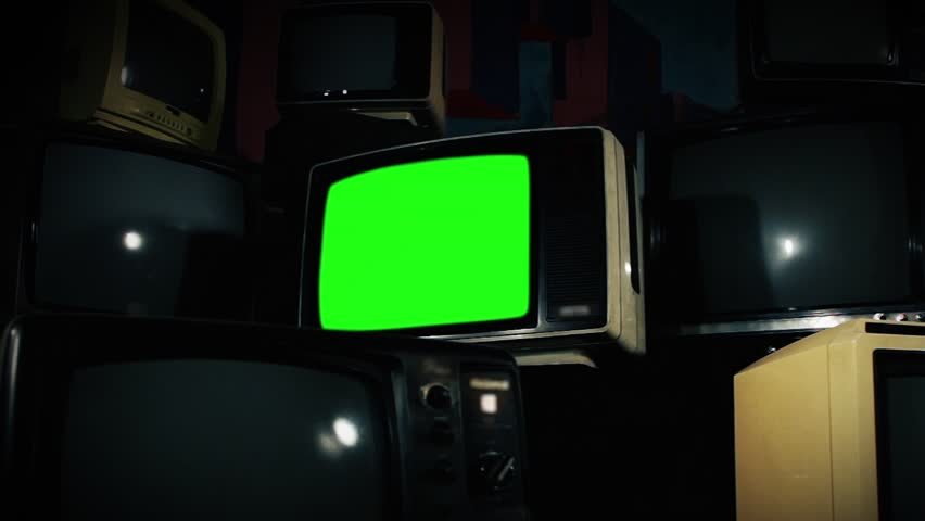Old Tv Green Screen with Many 1980s Tvs. Zoom Out Fast. Ready to replace green screen with any footage or picture you want. | Shutterstock HD Video #1009774067