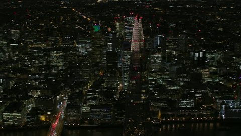 London UK - November 2017: Aerial view illuminated lights City of London skyline at night financial district skyscrapers Shard River Thames England UK RED WEAPON