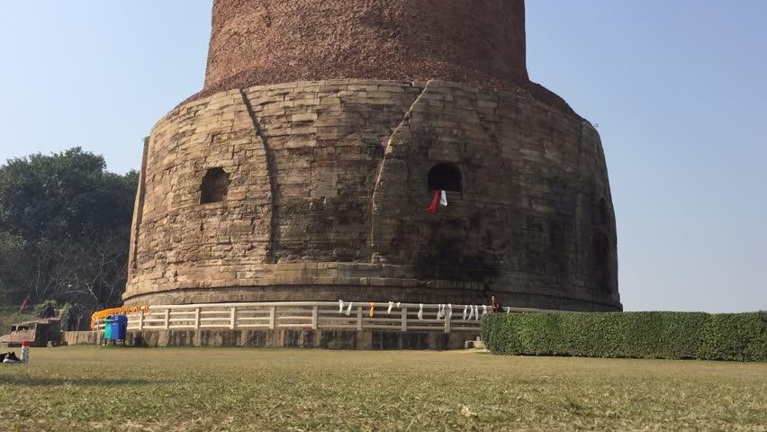 Sarnath, India - January 27, 2018: Dhamekh Stupa in Sarnath near Varanasi in Uttar Pradesh Region. Built in the 5th century AD, the Stupa is the birthplace of Buddhism.