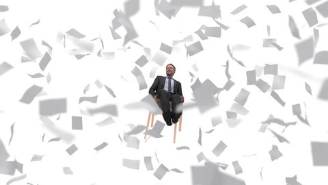 businessman among flying sheets of paper, looping