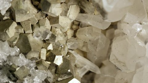 Macro view of Pyrite and Quartz spinning as it reflects the light.