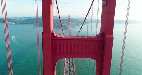 Flight through bridge resistance. Aerial view of the Golden Gate Bridge in fog. San Francisco. Drone. California. USA. 4K
