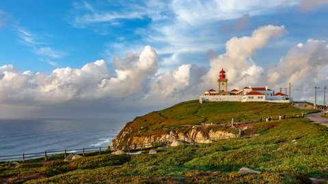 Wide angle time-lapse view of Cabo da Roca over the cliffs at dusk, Portugal. The most westerly point of the European mainland.