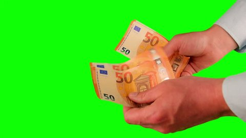 Counting money green screen. Get money cash, receive payment concept. Man's hand hold and counting cash money. Euro bills in the hand isolated at green background. Close up shot chroma key screen.