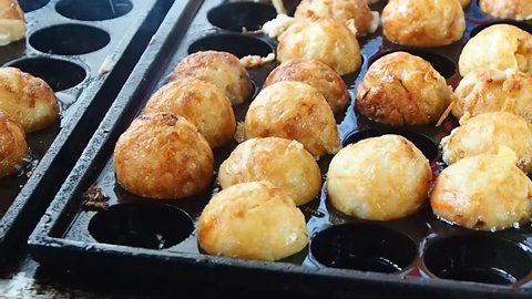 making Takoyaki  squid ball fried or grilled is a Japanese food. Dumpling dumplings are made of flour, milk and eggs mixed together