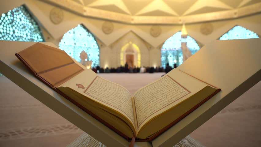 Quran or Koran - holy book and People praying in the blue mosque in istanbul noon prayer in congregation male Muslims Fatih Mosque Sultanahmet 4k sun rays with Sound  ISTANBUL, TURKEY - MARCH 18 2018   Shutterstock HD Video #1009942817