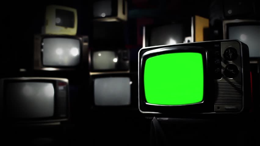 Vintage 80s Tv with Green Screen. Clean Straight Tone. Zoom In. Ready to replace green screen with any footage or picture you want.  | Shutterstock HD Video #1009948367