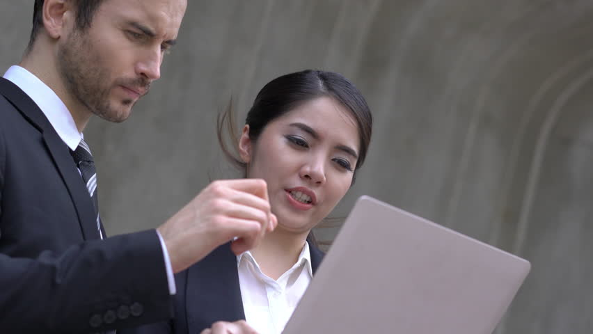 Businessman and Businesswoman talking discuss project together. Concept of project management, business meeting, strategy and performance.   Shutterstock HD Video #1009963127