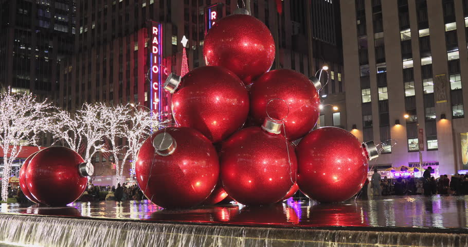 NEW YORK - DECEMBER 04: Illuminated Christmas holiday ornaments and Radio City Music Hall marquee with tourist walking in midtown Manhattan  on December, 04, 2016 in New York City.