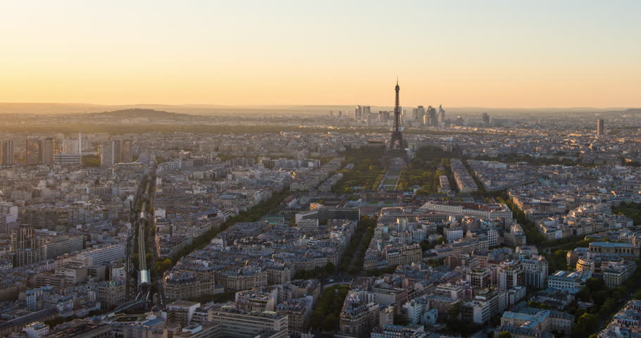 PARIS, FRANCE – SEPTEMBER 2016 : Timelapse over central Paris during a beautiful sunset with Eiffel Tower and skyline in view | Shutterstock HD Video #1009990697