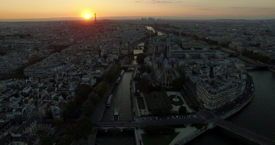 PARIS, FRANCE – SEPTEMBER 2016 : Aerial shot over central Paris island at sunset with view of Notre Dame, Eiffel Tower and river Seine | Shutterstock HD Video #1009990787