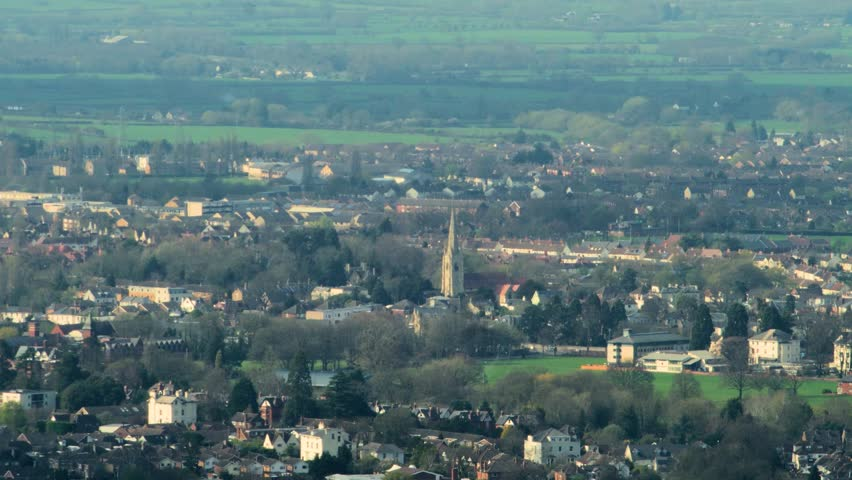 Distant town, Cheltenham, UK, with church steeple, shot with long vintage telephoto lens (part 2).