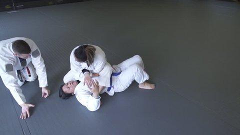 Instructor teaching Jiu-jitsu
