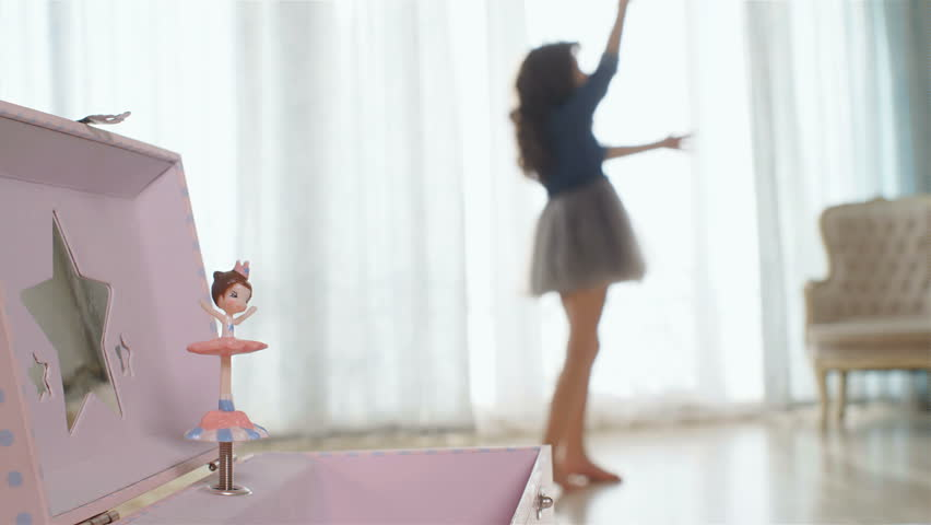 Music box with dancing rotating ballerina in front, dancing girl on the back, 4k