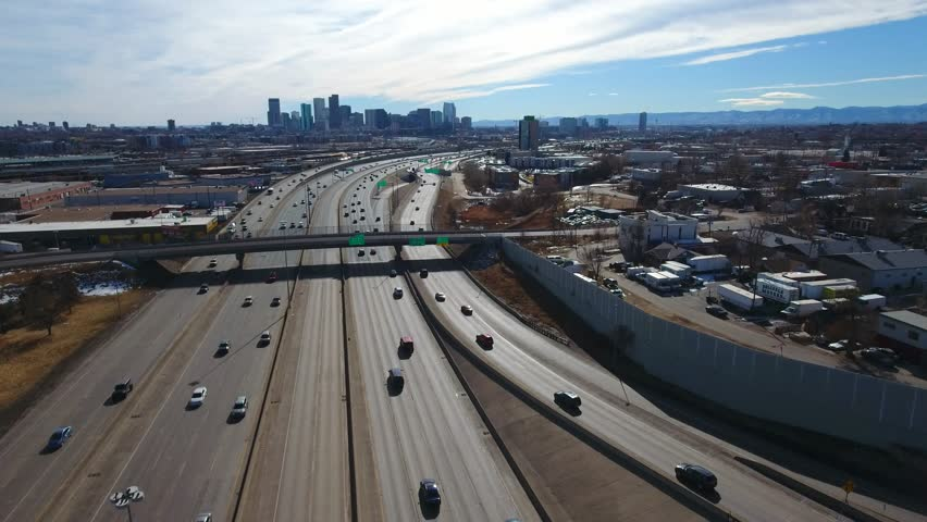 Aerial over traffic leading into downtown City of Denver Colorado
