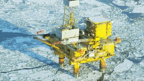 Aerial view of oil Rig surrounded by a frozen sea an offshore Industrial drilling platform in the Gulf of Alaska Northern Pacific America