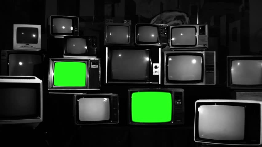 Aesthetic Televisions of the 80s with Green Screens that Light Up. Black and White Tone. Zoom Out. Ready to replace green screen with any footage or picture you want.  | Shutterstock HD Video #1010055347