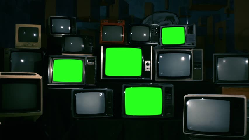 "Four Stacked 80s TVs Turning On Green Screen. Green Tone. Zoom In. You can replace Green Screen with any Footage or Picture you Want with ""Keying"" Effect in AE (check out tutorials on YouTube). 